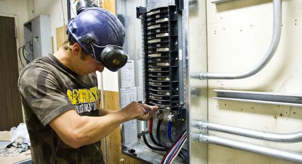 Man working on electrical wiring
